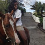 Saint James School of Medicine student Camille Renee horse trekking.