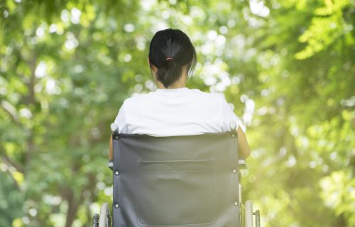 Woman with MS sitting in a wheelchair