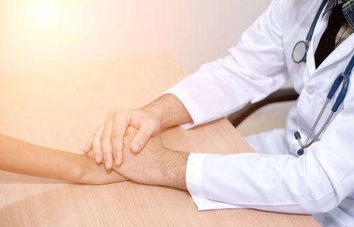 Empathetic doctor consoles patient